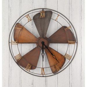 Industrial style fan clock, orange/brass rusty look propeller as a clock face.