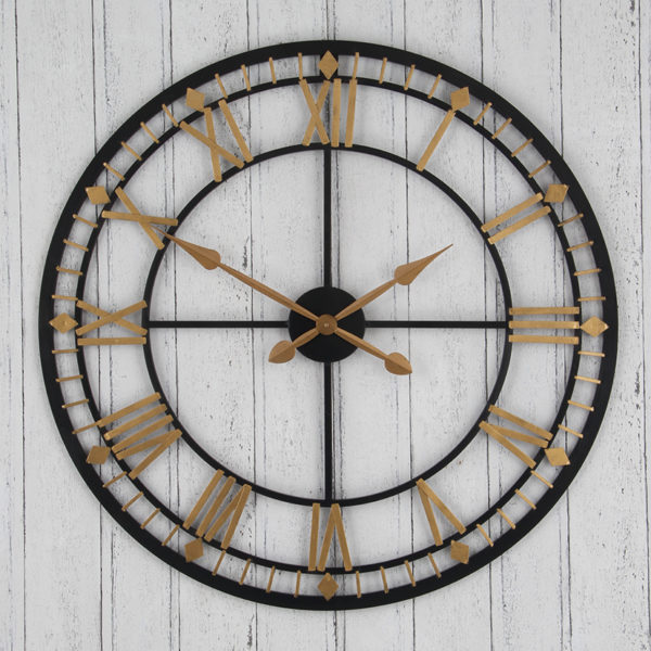 wall hanging antique bronze clock with gold Roman numerals and clock hands