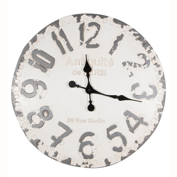 A distressed wall hanging clock with a white face and grey numbers