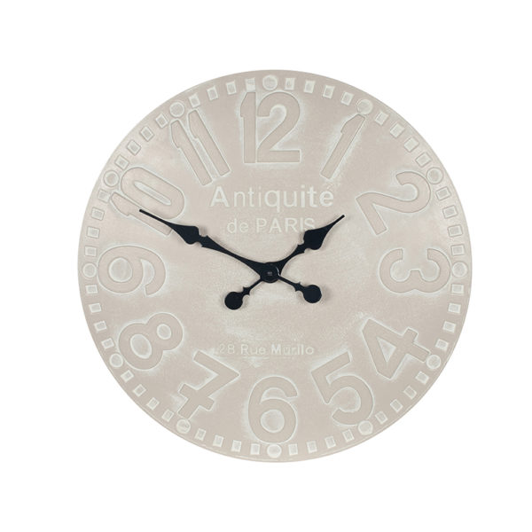 wall hanging clock with a dove grey face and faded white outlined numbers