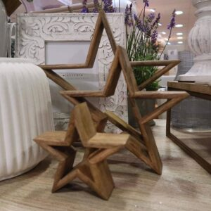Set of three wooden stars in size order. Can be styled inside one another or separately.