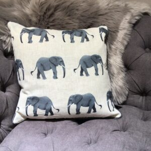 feather filled cushion with elephant repetitive design