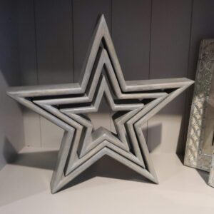 Set of three grey wooden stars inside one another with a distressed finish