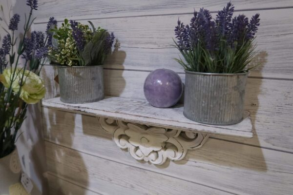 White washed wooden shelf, carved detail to the underside of the shelf