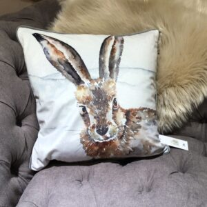 Hare image feather filled cushion with cream background