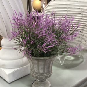 fake lilac flower potted in a goblet style grey plant pot